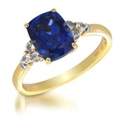 3.25 Carat TW Created Blue Sapphire, Genuine White Topaz & Diamond Accent Ring in 10K Yellow Gold